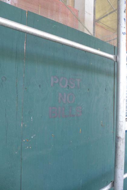 post no bills black on green