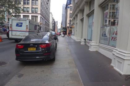 car parked on White St sidewalk