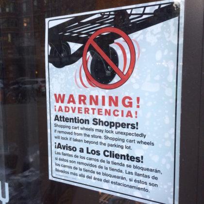 whole-foods-locking-shopping-cart-sign